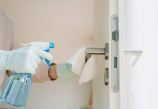 The U.S. Centers for Disease Control and Prevention recommends daily cleaning and disinfection of frequently touched surfaces including doorknobs, light switches and more with a disinfection spray and disposable wipes. (iStock)